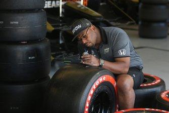 Arrow Schmidt Peterson Motorsports crew member checks tires