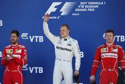 Race winner Second place Valtteri Bottas, Mercedes AMG F1 Sebastian Vettel, Ferrari, Third place Kim
