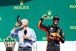 Sir Patrick Stewart drinks champagne from the shoe of Daniel Ricciardo, Red Bull Racing, on the podi