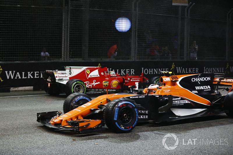 Stoffel Vandoorne, McLaren MCL32, passes the crashed car of Sebastian Vettel, Ferrari SF70H
