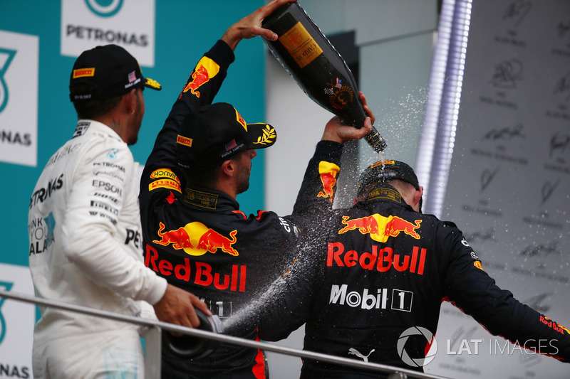 Lewis Hamilton, Mercedes AMG F1, Daniel Ricciardo, Red Bull Racing, spray champagne over winner Max Verstappen, Red Bull Racing, on the podium