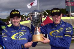 Richard Burns and Robert Reid celebrate with the winners trophy