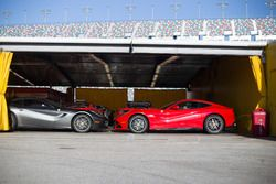 A pair of Ferrari F12berlinetta in the paddock area