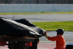 A marshal assists in loading the Jolyon Palmer Renault Sport F1 Team RS17 onto the back of a truck