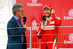 Eddie Jordan, sur le podium avec le deuxième, Sebastian Vettel, Ferrari