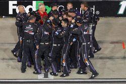 The crew of Denny Hamlin, Joe Gibbs Racing Toyota celebrates