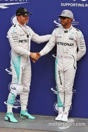 Polesitter Nico Rosberg, Mercedes AMG F1 in parc ferme with team mate Lewis Hamilton, Mercedes AMG F1