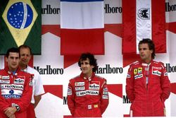 Podium: race winner Alain Prost, McLaren, second place Ayrton Senna, McLaren, third place Gerhard Be