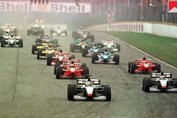 Mercedes team mates, David Coulthard and Mika Hakkinen lead the field into the first corner