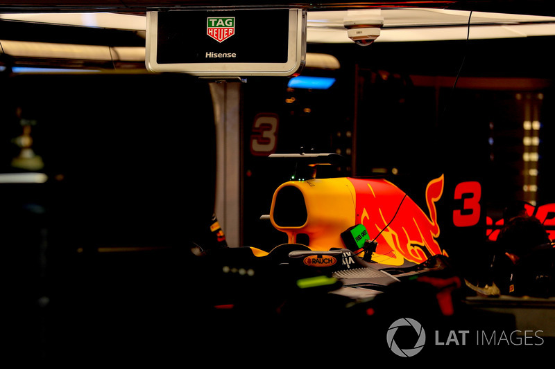 The car of Daniel Ricciardo, Red Bull Racing RB13 is worked on by mechanics in the garage