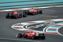 Kimi Raikkonen, Ferrari SF70H and Max Verstappen, Red Bull Racing RB13 battle with Sebastian Vettel,