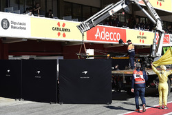 The car of Fernando Alonso, McLaren MCL33 is recovered to the pits hidden by screens