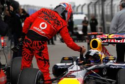 Jenson Button, McLaren, congratulates Sebastian Vettel, Red Bull Racing RB7 Renault, on pole in Parc Ferme