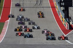 Lewis Hamilton, Mercedes AMG F1 W08, battles with Sebastian Vettel, Ferrari SF70H, ahead of the rest of the field