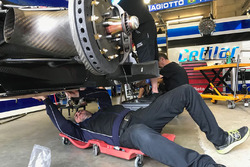Crew members repair the #47 Cetilar Villorba Corse Dallara P217 Gibson