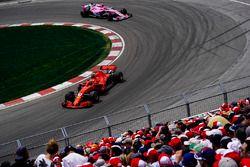Kimi Raikkonen, Ferrari SF71H, leads Esteban Ocon, Force India VJM11