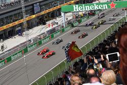 Sebastian Vettel, Ferrari SF71H leads Kimi Raikkonen, Ferrari SF71H at the start of the race