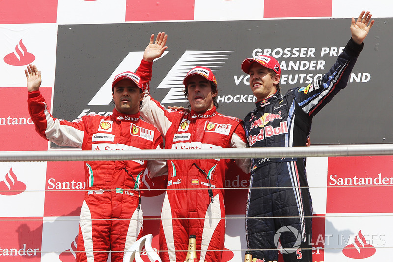 2010: Race winner Fernando Alonso, Ferrari, second place Felipe Massa, Ferrari and third place Sebastian Vettel, Red Bull Racing