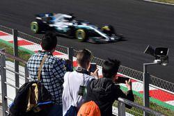 Fans watch Valtteri Bottas, Mercedes-AMG F1 W09