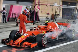 Kimi Raikkonen, Ferrari SF71H retries from the race in pit lane