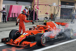 Kimi Raikkonen, Ferrari SF71H retries from the race in pit lane