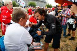 Fernando Alonso, McLaren, meets some fans