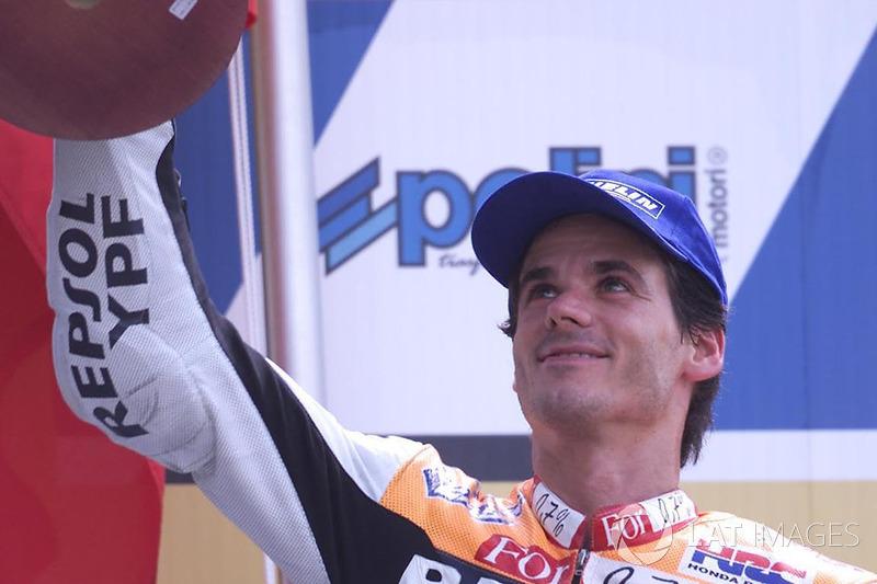 Podio: 1º Alex Criville, 2º Norick Abe, 3º Valentino Rossi