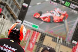 Crew member of Juan Pablo Montoya, Team Penske Chevrolet watches him on a big screen