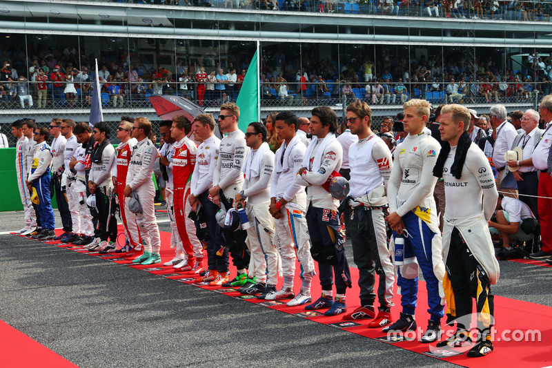 The drivers as the grid observes the national anthem