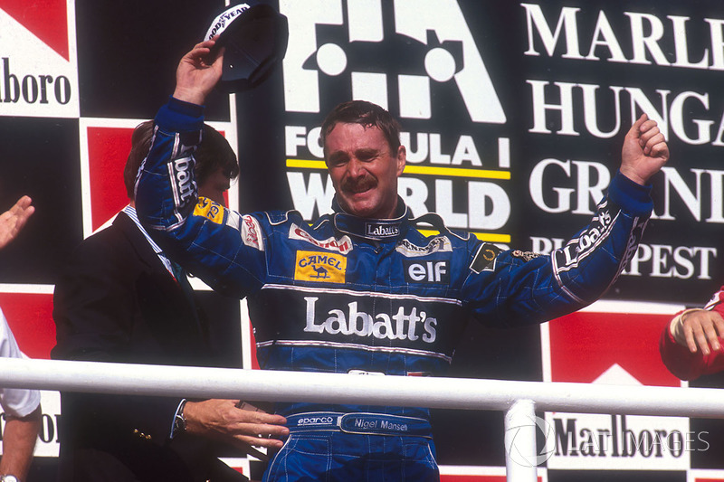 Podium: second place Nigel Mansell, Williams Renault celebrates winning the drivers World Championship