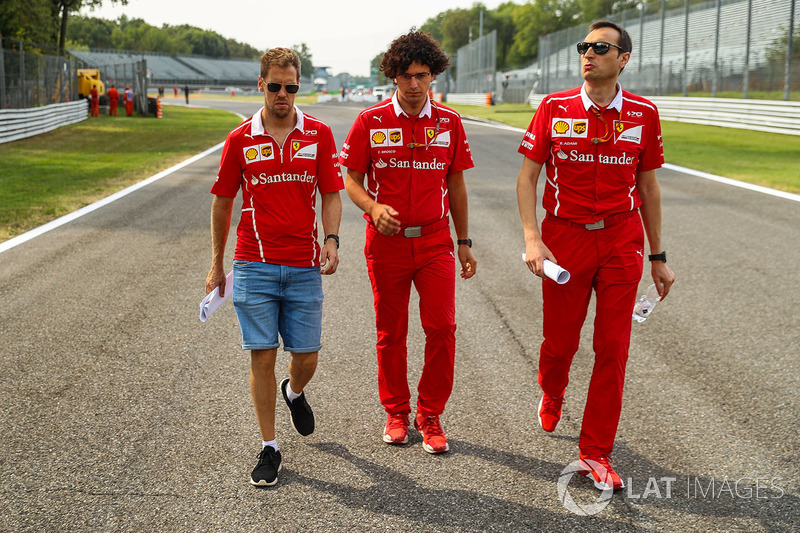 Sebastian Vettel, Ferrari and Riccardo Adami, Ferrari Race Engineer walk the track