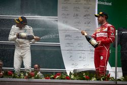 Podium: Lewis Hamilton, Mercedes AMG, and Sebastian Vettel, Ferrari, spray with Champagne on the podium