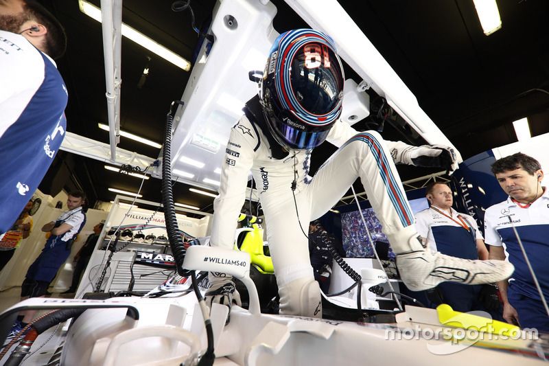 Lance Stroll, Williams, climbs in to his car