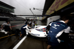 Lance Stroll, Williams FW40, is returned to the garage