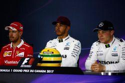 The post-qualifying press conference: Lewis Hamilton, Mercedes AMG F1, shows off his Ayrton Senna helmet, a gift after equalling the Brazilian's pole record, alongside Sebastian Vettel, Ferrari, Valtteri Bottas, Mercedes AMG F1