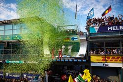 Confetti showers the top three drivers on the podium