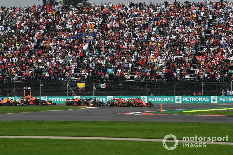 Charles Leclerc, Ferrari SF90, leads Sebastian Vettel, Ferrari SF90, Alexander Albon, Red Bull RB15, Lewis Hamilton, Mercedes AMG F1 W10, Max Verstappen, Red Bull Racing RB15, and the rest of the field at the start