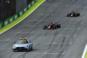 The Safety Car leads Max Verstappen, Red Bull Racing RB15, and Alexander Albon, Red Bull RB15