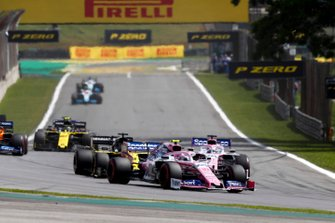 Lance Stroll, Racing Point RP19, leads Sergio Perez, Racing Point RP19, and Daniel Ricciardo, Renault F1 Team R.S.19