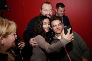 Lando Norris, McLaren takes a selfie with some fans
