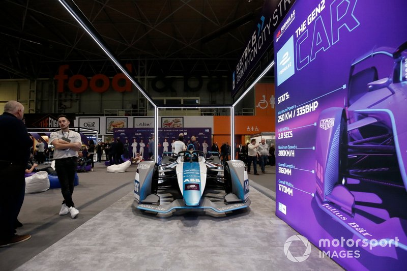 The Formula E car on the stand