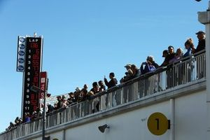 Fans watch practice from the roof of the garages