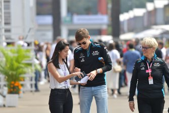 George Russell, Williams Racing, signs an autograph