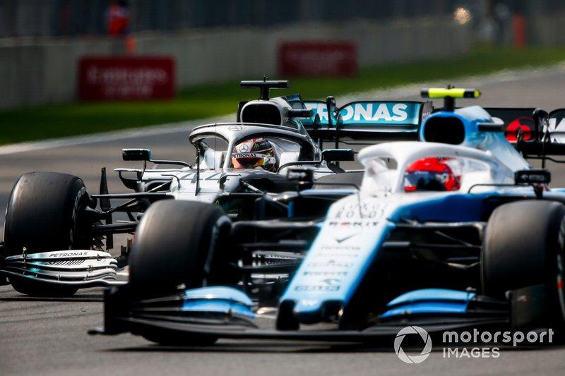 Lewis Hamilton, Mercedes AMG F1 W10, puts a lap on Robert Kubica, Williams FW42