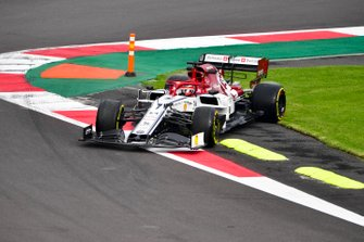 Kimi Raikkonen, Alfa Romeo Racing C38 runs over the grass