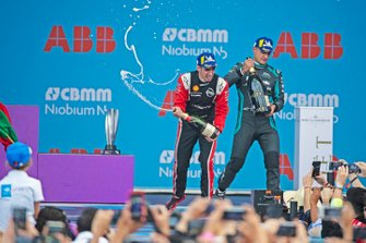 Sébastien Buemi, Nissan e.Dams, 3rd position, celebrates on the podium with race winner Mitch Evans, Jaguar Racing