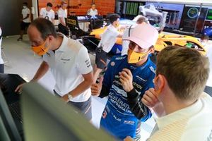 Daniel Ricciardo, McLaren, in the garage with engineers