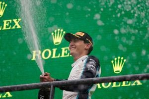 George Russell, Williams, 2nd position, sprays Champagne on the podium