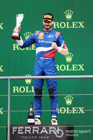 Third-placed Alexander Smolyar, ART Grand Prix on the podium