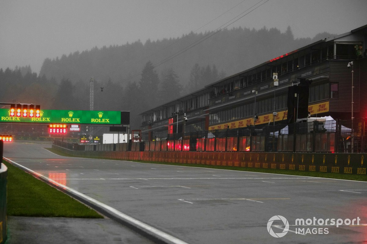 Red flag lights around the soaked circuit